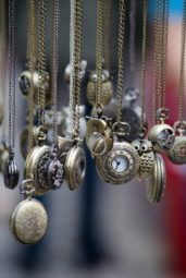 Many pocket watches hanging by chains