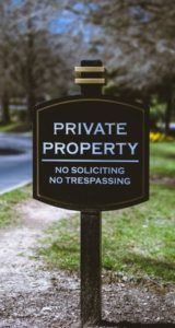 Brown Sign Private Property No Soliciting No Trespassing